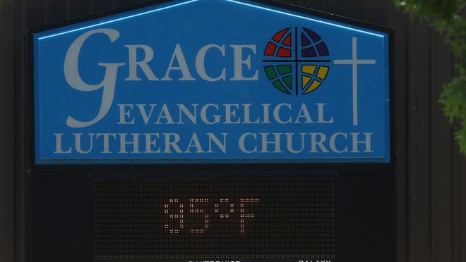 The Grace Evangelical Lutheran Church sign gives the temperature at 95 degrees Monday afternoon in Dover.