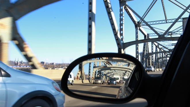 Southbound afternoon rush hour traffic moves across the Brent Spence Bridge in February.