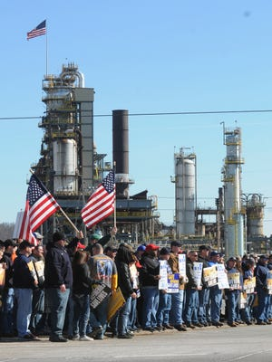 Representatives from the United Steel Workers Union (USW) hold a rally at the entrance to the Marathon refinery in Catlettsburg, Ky. Saturday Feb. 7, 2015. About 3,800 steelworkers began a strike Feb. 1 at refineries from California to Kentucky, saying that negotiations with Shell Oil Co. had broken down. Shell is negotiating the national contract for other oil companies.