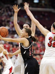 Newark's Ali Cartnal scoops a shot between Lakota West defenders during a Division I state semifinal this past March.