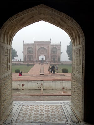 Peaked and scalloped arches, like these at the Agra Fort, are a signature element of Moghul architecture.