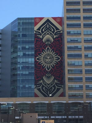 Street artist Shepard Fairey's completed mural at One Campus Martius.