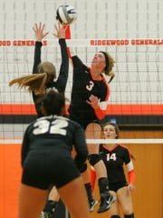 Ridgewood senior Laura Crawford spikes the ball on Central Catholic Thursday night during the Generals' 3-2 loss.