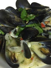 Steamed Mussels with Tequila, Red Chili, Green Jalapeno, Coconut Milk, Lime and Cilantro.