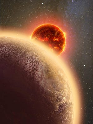 This conception shows GJ 1132b, left, a planet like Earth in size and mass, orbiting a red dwarf star.