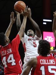 Rutgers Mike Williams tries a second half shot over Howard's Oliver Ellison and Damon Collins, Sunday, November 15, 2015, at the Louis Brown Athletic Center in Piscataway.