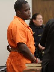 Gregory Jean-Baptiste is arraigned for the murder of Red Bank school teacher Jonelle Melton, Thursday, November 19, 2015, before Judge Anthony Mellaci in Freehold.