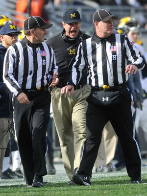 Michigan head coach Jim Harbaugh yells at the officials during Saturday's game at Beaver Stadium. Harbaugh was his typical animated self throughout the contest, as the No. 14-ranked Wolverines topped Penn State 28-16.