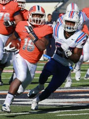 UTEP tailback TK Powell sprints away from Louisiana Tech's Kentrell Brice for a long gain Saturday. Powell rushed for 116 yards on 10 carries last week.