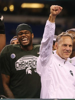 Michigan State Spartans head coach Mark Dantonio celebrates after the 16-13 win against the Iowa Hawkeyes in the Big Ten Championship on Saturday, December 5, at Lucas Oil Stadium in Indianapolis Indiana.
