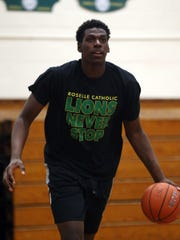Roselle Catholic's Nazreon Reid works out during a
