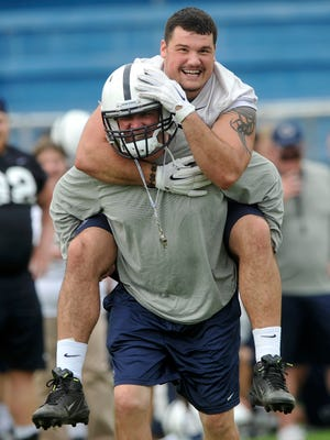 Penn State senior Anthony Zettel gets carried across the field by defensive coordinator Bob Shoop following the Nittany Lions' last practice at Fernandina Beach High School in Fernandina Beach, FL on Thursday, Dec. 31, 2015. The team is preparing to play Georgia in the TaxSlayer Bowl on Saturday, Jan. 2, 2015.