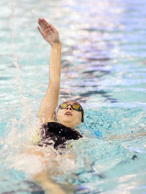 Watkins Memorial junior Gracie Gessner competes Monday in the 100 backstroke during a meet against Granville at Denison.