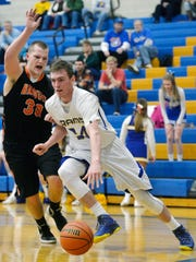 Kennard-Dale's Kyle Wooldridge (right) drives to the basket during his high school career.