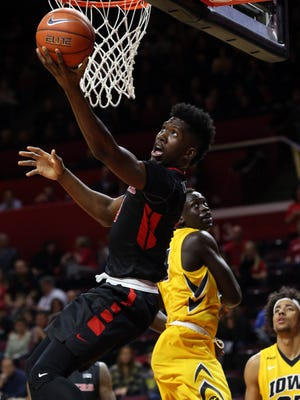 Rutgers Jonathan Laurent drives past Peter Jok of Iowa for a first half basket, Thursday, January 21, 2016, at the Louis Brown Athletic Center in Piscataway.