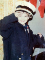 Hopelawn firefighter Brian Turcotte at age 3, wearing his father Bruce Turcotte's firefighter's hat and dress blue coat.  COURTESY OF BRIAN TURCOTTE