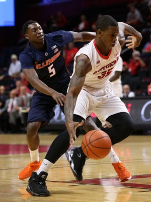 Rutgers Greg Lewis drives past Jalen Coleman-Lands of Illinois during the first half, Wednesday, February 3, 2016, at the LBAC in Piscataway.