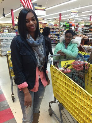 LaMonica Brooks of Flint shops at Landmark Foods in Flint. Consuming foods rich in three key nutrients — calcium, iron and vitamin C — can prevent lead from being absorbed in the body.
