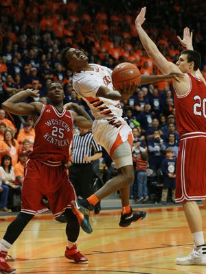 UTEP's Lee Moore puts up a shot between Western Kentucky's Aleksej Rostov, right, and Frederick Edmond Saturday.