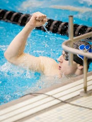 Dallastown's Grant Wertz celebrates at the wall after winning the 100-yard breaststroke for a pool, meet and league record during the YAIAA swimming championships on Friday, Feb. 12, 2016.