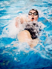 Dallastown's Kacey Oberlander follows through as she wins the 100-yard backstroke during the YAIAA league swimming championship in February.