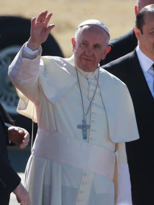 Pope Francis waves to the throngs gathered for his arrival Wednesday at Abraham Gonzalez Airport in Ciudad Juárez, Chihuahua, Mexico.