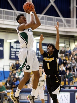 Tyus Battle of St. Joseph puts up a first quarter jumper over Danesh Thirukumaran of South Brunswick during the GMC Tournament final on Thursday at Kean University.