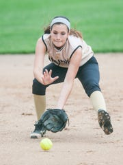 Delone Catholic shortstop Shelbee Holcomb fields a grounder during a state tournament game in June.