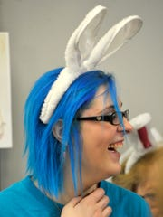 """Alesia Doll, a volunteer with the SPCA, sports bunny ears while helping out at """"Bunfest"""" at the York County SPCA on Saturday, March 19, 2016. The event, which allowed visitors to learn about rabbit care and even adopt them, additionally offered up photographs with bunnies and a variety of vendors."""