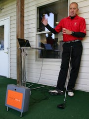 Jeff Jackson, owner of Granville Golfland, explains how the new Trackman Launch Monitor is used to evaluate a swing — a device that collects data useful in club fitting.