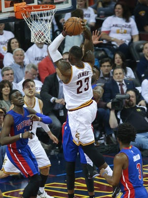 Pistons guard Reggie Jackson defends against Cavaliers forward LeBron James during the second period of the Pistons' Game 2 loss Wednesday in Cleveland.