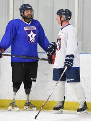 Each Wednesday, injured vets like North Codorus Township's Rich Garrison, right, and teammate Michael Cain practice together with the USA Warriors in Rockville, Md. Cain, an Army vet like Garrison, ended up losing both of his legs from injuries suffered in Iraq in 2003. Garrison, like most on their team, are disabled from internal scars, like traumatic brain injuries and Post Traumatic Stress Disorder. The Warriors provide the most unique  opportunity to be around others like them, vets who understand them. They call it a therapy of sorts.