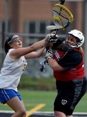Kennard Dale's Maddie Day puts the pressure on Susquehannock' goalie Tess Clancy during the Rams' 13-8 victory in Red Lion on Tuesday, May 10, 2016.