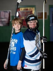 """""""I like to help people and I like to play hockey, so it's pretty much my two favorite things,"""" said Caleb Olver, 12, left, a member of the York Devil Ice Hockey Team, who mentors Adam Bernhardt, 12 a down syndrome athlete who plays for the York Polar Bears, a team for special needs children."""