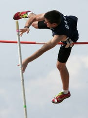 Granville junior Barry Bait competes in the pole vault May 12 during the Licking County League-Buckeye Division meet. Bait cleared 13 feet to win the event.