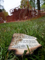 "A charred page from ""The Wizard of Oz"" sits in the backyard after a fire destroyed a home in Lower Windsor Township."