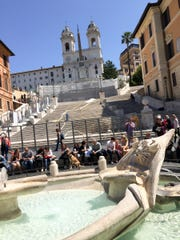 The Spanish Steps getting a makeover in Rome, Italy. Funded by Bulgari, images of famous Italian movie stars dot the barricades.