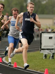 Granville senior Tyler Keenan competes in the 4x800 relay May 25 during the Division I regional meet.