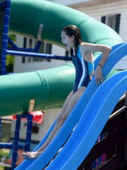 Megan Doll, a seventh-grader from South Western Middle School, lets out a scream as she slides into the pool at Lincolnway Swimming Pool and Sports Club.