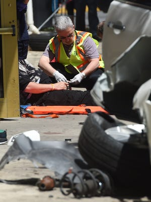 Emergency workers tend to a man after York County 911 reported that a car struck pedestrians along King and South George streets. White Rose Ambulance reports that five were injured, including the driver. Two sustained serious injuries.