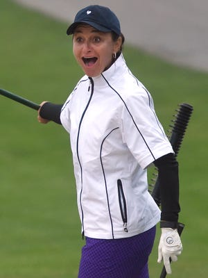 Amy Kennedy reacts after hitting a birdie out of the sand trap on the second hole at the Outdoor Country Club on Thursday, June 16, 2016. Kennedy won her third consecutive Women's York County Amateur Golf Association championship, beating Connie Shorb.