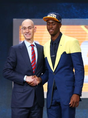 Caris LeVert (Michigan) greets NBA commissioner Adam Silver after being selected as the No. 20 overall pick to the Pacers in the first round of the 2016 NBA draft at Barclays Center.