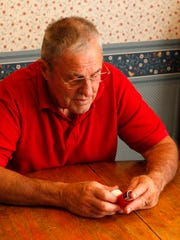 After 21 years of employment at a Simco Mine, Norman Skinner, 79, uses inhalers daily to help him breath.