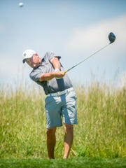 Matt Henry tees off on the 18th hole during the York