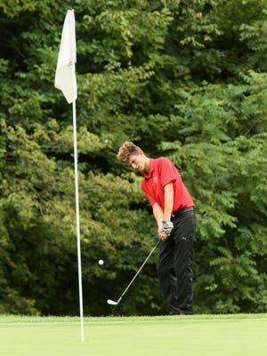 Sheridan's Costa Coconis chips onto the 11th green on Monday during the Licking Valley Invitational at The Virtues.