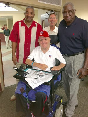 "Ruston Leader Sports Editor O.K. ""Buddy"" Davis, center,  was honored Tuesday night as part of the Smithsonian Institute's Hometown Teams traveling exhibit on display at the library. With him afterwards are NFL MVP Bert Jones (center) and former NBA stars Aaron James and Willis Reed."