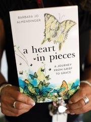 "Barb Almendinger, a teacher at Utica Middle School, wrote the book ""A Heart in Pieces, A Journey from Grief to Grace,"" that stemmed from her coping with the loss of her eight year old daughter. Almendinger also brings a popular therapy dog to school with her several days a week. The school showed its appreciation recently with a plaque."