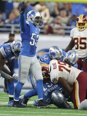 Detroit Lions linebacker Kyle Van Noy celebrates the fumble recovery by Kerry Hyder against the Washington Redskins on Sunday, Oct. 23, 2016, in Detroit.