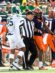 Field judge Timothy Maquire interrupts a discussion between Illinois defensive back Jaylen Dunlap (right) and Michigan State receiver Darrell Stewart Jr. during the first quarter at Memorial Stadium on Nov 5, 2016. The Spartans' 31-27 loss that day was their seventh in a row that season.