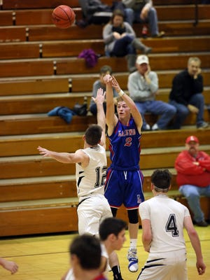Lakewood senior Cameron Downs shoots for three over River View junior Jorn Hocter Tuesday during the Lancers' 76-46 victory.